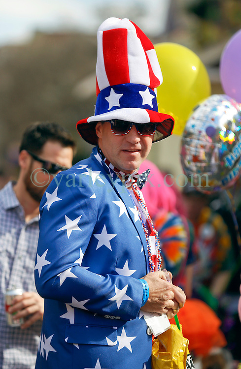 31 January 2016. New Orleans, Louisiana.<br /> Mardi Gras Dog Parade. Andy Wilcox in patriotic costume. The Mystic Krewe of Barkus winds its way around the French Quarter with dogs and their owners dressed up for this year's theme, 'From the Doghouse to the Whitehouse.' <br /> Photo©; Charlie Varley/varleypix.com