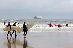 Surfers on an October afternoon; Tynemouth; North Sea UK