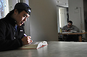 Ohio University student Jihoon Wi studying at the Student Writing Center in Alden library.