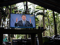 A television shows Colombian President Juan Manuel Santos giving his speech at the ceremony where he was awarded the Nobel Peace Prize, in a FARC camp in the remote Putumayo region of Colombia, on December 10, 2016. (Photo/Scott Dalton)
