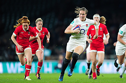 Emily Scarratt of England takes on the Argentina defence - Mandatory byline: Patrick Khachfe/JMP - 07966 386802 - 26/11/2016 - RUGBY UNION - Twickenham Stadium - London, England - England Women v Canada Women - Old Mutual Wealth Series.