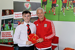 NEWPORT, WALES - Sunday, May 28, 2017: Liam Snowden receives a cap from Elite Performance Director Ian Rush for participation during day three of the Football Association of Wales' National Coaches Conference 2017 at Dragon Park. (Pic by Mark Roberts/Propaganda)