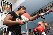 1 Nov. 2013 -New York, NY- Boxing coach Teresa Scott of Women's World of Boxing trains Bethany Holmstrom at Mendez Boxing. Scott hopes to open the first women only boxing gym in New York City. Photo credit: Tanisia Morris/NYCity Photo Wire
