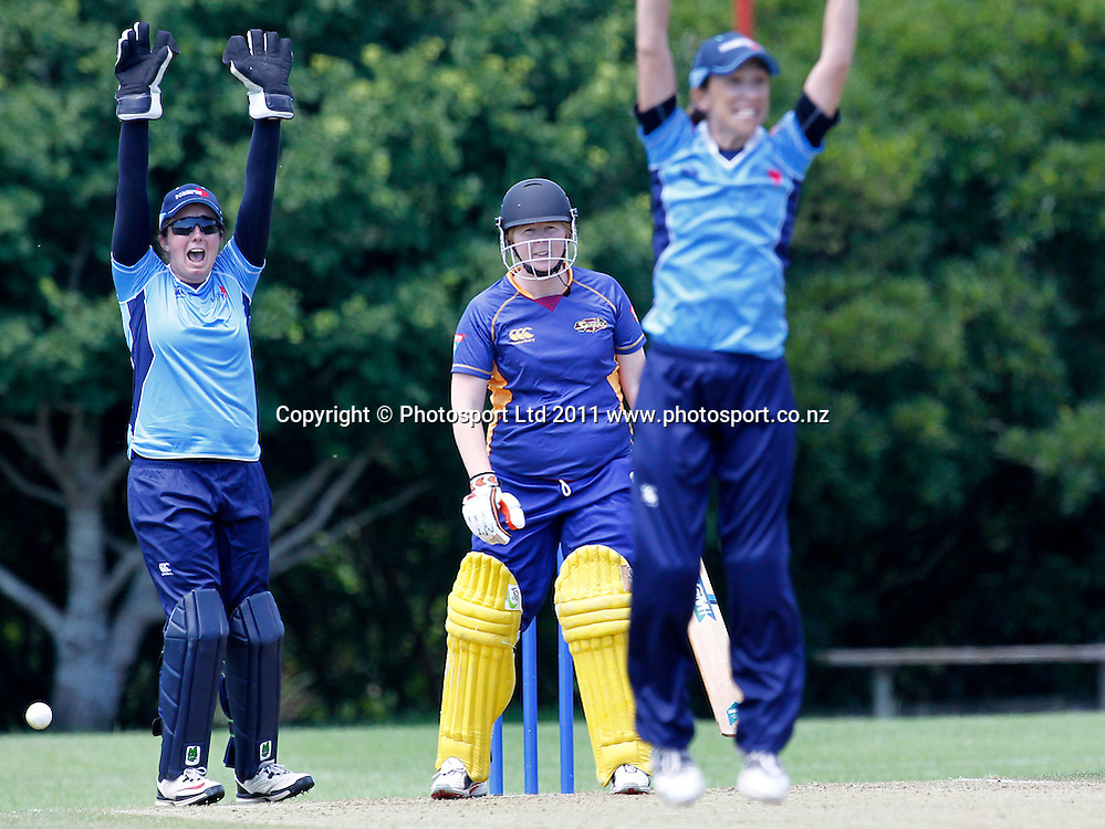 Sparks batsman Rebecca Heenan looks at the umpire as Hearts keeper Victoria Lind and bowler Paula Gruber appeal for LBW. Women's One Day Cricket, Action Cricket Cup, Auckland Hearts v Otago Sparks, Melville Park, Auckland, Monday 3 January 2011, . Photo: Simon Watts/photosport.co.nz