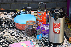 © Licensed to London News Pictures. 22/12/2016. London, UK. Food items and coffee on a rug where a group of Heathrow protestors and their supporters have set up a picnic area outside Ealing Magistrates Court in London, where 15 protestors are charged with Wilful Obstruction of the Highway after blocking an access road to Heathrow on November 18, 2016. Photo credit: Ben Cawthra/LNP