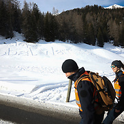 The third and last day of the Strike WEF march on Davos, 19th of January 2020, Switzerland. The two police officers escorting the march across the moutains. 'Stop Global Warming' is written in the snow. The authorities had refused perission for the march to walk on the road into Davos so many hiked across the mountains from Klosters to get there. The march is a three day protest against the World Economic Forum meeting in Davos. The activists want climate justice and think that The WEF is for the world's richest and political elite only.(photo by Kristian Buus/In Pictures via Getty Images)