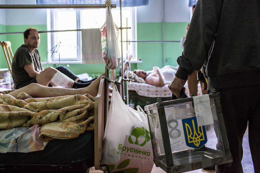 MARIUPOL, UKRAINE - MAY 11: A ballot box is carried into a hospital to allow patients who were wounded in clashes on May 9 to vote in a referendum on May 11, 2014 in Mariupol, Ukraine. A referendum on greater autonomy  is being held after pro-Russian activists took over at least ten cities in the eastern part of the country. (Photo by Brendan Hoffman/Getty Images) *** Local Caption ***
