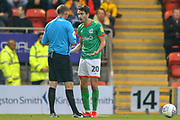 YELLOW CARD Scunthorpe United midfielder Alex Gilliead (20) protests with Referee Brett Huxtable after fouling Leyton Orient midfielder James Brophy (16) (not in picture) during the EFL Sky Bet League 2 match between Leyton Orient and Scunthorpe United at the Matchroom Stadium, London, England on 16 November 2019.