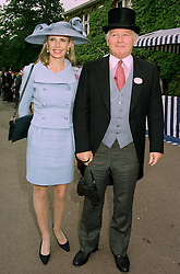 MR & MRS ROBERT SANGSTER the top British racehorse owner, at Royal Ascot on 17th June 1997.LZI 48