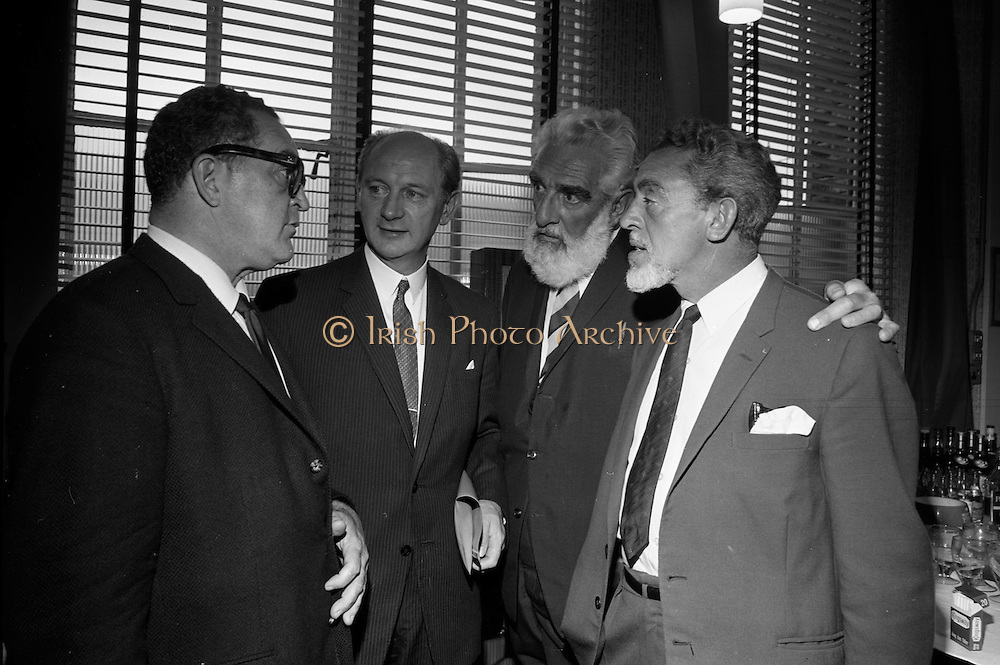 """17/08/1967<br /> 08/17/1967<br /> 17 August 1967<br /> Player and Wills (Ireland) Ltd. give development grant to Cork Film Festival at Player and Wills headquarters, South Circular Road, Dublin. Picture shows Taoiseach Jack Lynch T.D.,  (2nd from left0 chatting with William Graf (left), who was producing """"Sinful Davey"""" in Ireland and also producer for """"A Man for all Seasons""""; Mr Noel Purcell and Mr Eddie Byrne, Irish Film Personalities at the reception."""