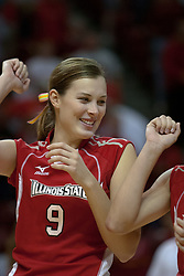 09 OCT 2005 Emily Kabbes lifts an arm in victory at the conclusion of the match. The Illinois State University Redbirds hosted arch rival Bradley University Braves.  The Redbirds soared over the Braves, taking the match in 4 games, losing only game number 2.  Action included play by Braves Star Lindsey Stalzer who is ranked no. 7 in the nation in kills per game.  The first defeat of the conference season for the Braves took place at Redbird Arena on Illinois State's campus in Normal IL.