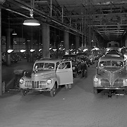 A 1940 Champion (l) and Commander (r) reach the end of Studebaker's assembly line.