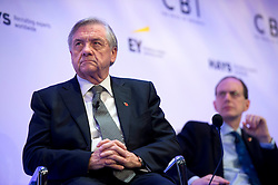 © London News Pictures. 04/11/2013 . London, UK.  Confederation of British Industry (CBI) President Sir MICHAEL RAKE (left) listening on stage during the 2013 Confederation of British Industry (CBI) Conference, held at the Hilton Metropole in London. . Photo credit : Ben Cawthra/LNP