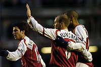 Fotball<br /> FA-cup 2005<br /> Arsenal v Wolves<br /> 29. januar 2005<br /> Foto: Digitalsport<br /> NORWAY ONLY<br /> Arsenal's Fredrik Ljungberg (arm raised) celebrates scoring his side's second goal with Thierry Henry (R) and Cesc Fabregas