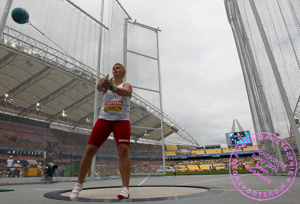 ANITA WLODARCZYK (POLAND) COMPETES IN WOMEN'S HAMMER THROW QUALIFICATION DURING IAAF WORLD CHAMPIONSHIPS ATHLETICS DAEGU 2011..KOREA , DAEGU , SEPTEMBER 02, 2011..( PHOTO BY © VICTAH SAILER / MEDIASPORT )