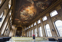 © Licensed to London News Pictures. 25/09/2016. LONDON, UK.  Visitors look at the main hall ceiling at the Painted Hall. The 300 year old Painted Hall by James Thornhill at the Old Royal Naval College closes today for two years. Major restoration work to remove layers of dirt to the fine dining room will be undertaken in the main hall, ceiling and dome. The project has been awarded a £3.1m Heritage Lottery grant.  Photo credit: Vickie Flores/LNP