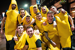 © Licensed to London News Pictures . 26/12/2018. Wigan, UK. Bananas arrive on Wallgate . Revellers in Wigan enjoy Boxing Day drinks and clubbing in Wigan Wallgate . In recent years a tradition has been established in which people go out wearing fancy-dress costumes on Boxing Day night . Photo credit: Joel Goodman/LNP