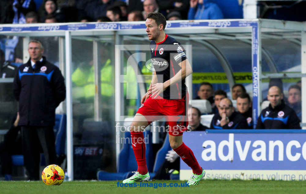 Chris Gunter of Reading in possession of the ball during the Sky Bet Championship match at St Andrews, Birmingham<br /> Picture by Tom Smith/Focus Images Ltd 07545141164<br /> 13/12/2014