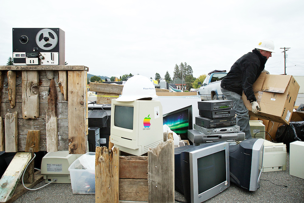 Eric York, with Urban Mining Depot, helps remove some of the electronic equipment that was brought into the e-waste collection site Friday in Coeur d'Alene.