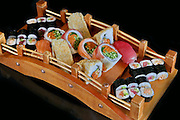 An assortment of various types of sushi including: Sushi Maki, futo maki, Insideout