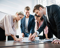 Young business people brainstorming at conference table