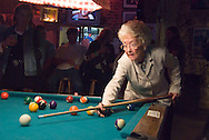 Clarksdale, Mississippi, February, 2009. A woman plays snooker billiard at Ground Zero. Live bLues music in one of the jukejoints in CLarksdale. Clarksdale is home of the Delta blues tradition that started in the cotton field and the Juke joints by the black sharecroppers. Photo by Frits Meyst/Adventure4ever.com