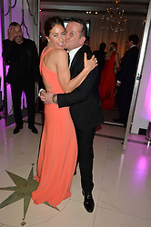 LISA SNOWDON and ROB VAN HELDEN at the QBF Spring Gala in aid of the Red Cross War Memorial Children's Hospital hosted by Heather Kerzner and Jeanette Calliva at Claridge's, Brook Street, London on 12th May 2015.