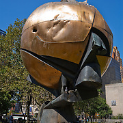 "For three decades, this sculpture stood in the plaza of the World Trade Center. Entitled ""The Sphere,"" it was conceived by artist Fritz Koenig as a symbol of world peace. It was damaged during the tragic events of September 11, 2001, but endures as an icon of hope and the indestructible spirit of the United States of America. The Sphere was placed here in Battery Park at the lower tip of Mahattan Island on March 11, 2002 as a temporary memorial to all who lost their lives in the terrorist attacks at the World Trade Center."