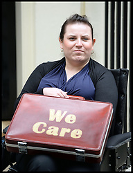Angela Murray hands in a petition into Downing Street, London, United Kingdom, with 45,000 signatures calling on the Government to urgently invest in local support for disabled people and calling for calling for more funding for social care. Monday, 24th June 2013. Picture by Andrew Parsons / i-Images