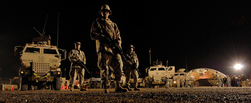 """(l.-r.) Tech. Sgt. Andrew Morin, Staff Sgts. Jeremy Garcia and Frank Stibler, keep an eye on how the 181 Transportation Battalion?s convoy security team prepare their convoy escort platforms and rehearse a """"snatch and grab"""" procedure. Sgts. Morin and Stibler are evaluators, and Garcia is the convoy guide. These three are the last U.S. Air Force personnel to participate in the U.S. Air Force combat convoy security team mission, now returned to the Army. Garcia is one of the few; most experienced combat convoy security team members in Iraq.  He has continuously served in Iraq, since the inception of this in-lieu of mission for the Army, 18-months ago. Then, the Army Trucking Company, Det. 2632 was handling the mission. When the Army called for help, the U.S. Air Force stepped in and was best known by and operated with the Army detachment?s designation rather than the Air Force?s 732 Expeditionary Logistics Readiness Squadron, Detachment 2.  (U.S. Air Force photo by Master Sgt. Lance Cheung)"""