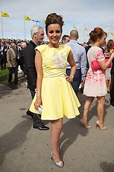 LIVERPOOL, ENGLAND - Friday, April 4, 2014: Lauren Henerty from Ormskirk wearing Mark Melia during Ladies' Day on Day Two of the Aintree Grand National Festival at Aintree Racecourse. (Pic by David Rawcliffe/Propaganda)