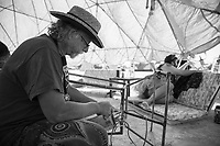 Every time I dropped in on Harold he was always working on something. Legit burner all the way. (The color got all fucked up here so I made this one black and white. We we're inside Camp Awesomesauce's pink dome when I shot this. Hard to get good color inside a completely pink dome!) My Burning Man 2018 Photos:<br />