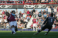 Photo: Lee Earle.<br /> West Ham United v Middlesbrough. The Barclays Premiership. 31/03/2007.United's Carlos Tevez (L) beats Boro' keeper Mark Schwarzer to score their second.