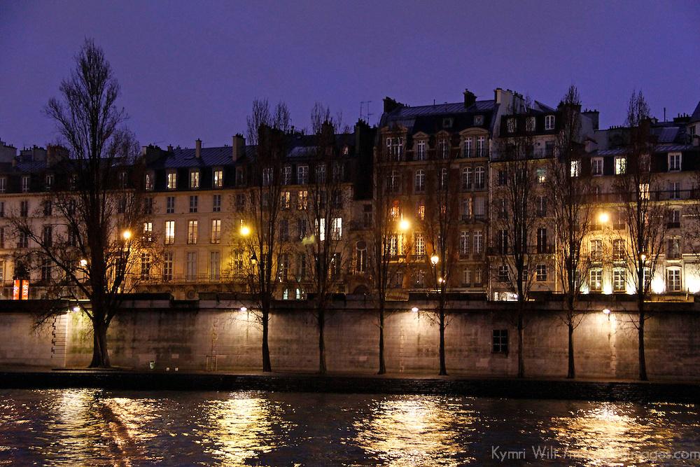 Europe, France, Paris.Paris embankment lights at twilight.