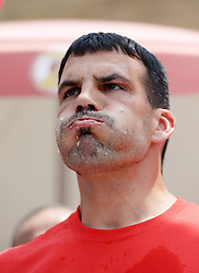Image ©Licensed to i-Images Picture Agency. 03/07/2014. D.C.  Washington, United States. <br /> 61801395<br /> David Brunelli competes during the 6th annual Independence Burger Eating Championship in Washington D.C., the United States, on July 3, 2014. David Brunelli won the third place and 500 dollars by eating 20 burgers in 10 minutes. Picture by  imago / i-Images<br /> UK ONLY