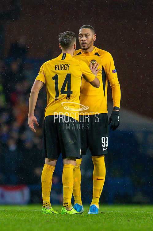 Nicolas Burgy (#14) of BSC Young Boys speaks with Guillaume Hoarau (#99) of BSC Young Boys during the Europa League Group G match between Rangers FC and BSC Young Boys at Ibrox Park, Glasgow, Scotland on 12 December 2019.