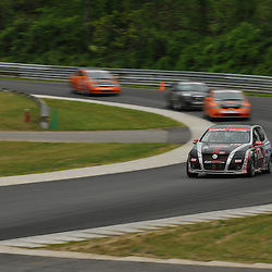 May 23, 2009; Lakeville, CT, USA; The APR Motorsport Volkswagen GTI driven by Ian Baas and Josh Hurley leads the Grand-Am Koni Sports Car Challenge series competition during the Memorial Day Road Racing Classic weekend at Lime Rock Park.