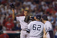 Alex Rodriguez, left, swats away bugs as Joba Chamberlain, center, walks back to the mound after a line out by Travis Hafner to Doug Mientkiewicz in the eighth inning of Game 2 of the 2007 ALDS at Jacobs Field in Cleveland.
