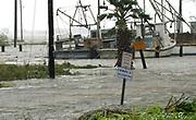 A flooded street  from Hurricane Harvey warns against alligators in Seadrift, Texas August 26, 2017. REUTERS/Rick Wilking