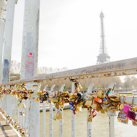 Locks are adhered to a bridge that crosses The Seine River as the Eiffel Tower looms in the background in Paris, France, in April, 2015. Parisians and visitors began adding locks to Pont des Arts bridge nearby years ago, and began adding locks to nearly every bridge that crosses the Seine River like the one seen here. In 2015, Paris authorities began removing the original sections of the Pont des Arts because the heavy weight of the locks were threatening the bridge that was constructed in the 1800's.