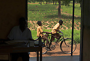 Two boys ride a bicycle outside a classroom in session at the Ying Anglican Primary School in the Savelugu-Nanton district, northern Ghana on Monday June 4, 2007.