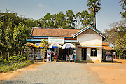 "30 JANUARY 2013 - CHEOUNG EK, CAMBODIA: The gift shop at the Choeung Ek Killing Fields. Choeung Ek is a former orchard and Chinese cemetery about 17 km south of Phnom Penh, Cambodia. It is the best-known of the ""Killing Fields"", where the Khmer Rouge regime executed over one million people between 1975 and 1979. Mass graves containing 8,895 bodies were discovered at Choeung Ek after the fall of the Khmer Rouge regime. Many of the dead were former political prisoners who were kept by the Khmer Rouge in their Tuol Sleng detention center, a former high school in Phnom Penh.      PHOTO BY JACK KURTZ"
