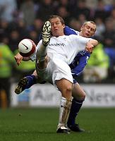 Photo: Paul Thomas.<br /> Bolton Wanderers v Everton. The Barclays Premiership. 09/04/2007.<br /> <br /> Goal scorer Kevin Davies (L) of Bolton battles with Tony Hibbert.