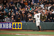 Fans celebrate as San Francisco Giants first baseman Brandon Belt (9) makes a foul ball catch against the Cincinnati Reds at AT&T Park in San Francisco, California, on May 11, 2017. (Stan Olszewski/Special to S.F. Examiner)