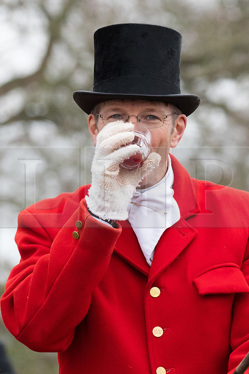 © Licensed to London News Pictures. 26/12/2018. London, UK.  The hunt master has a drink before taking part in the traditional Chiddingfold, Leconfield and Cowdray Boxing Day Hunt, which sets off from the kennels at Petworth House in Petworth Park, West Sussex.  Photo credit: Vickie Flores/LNP