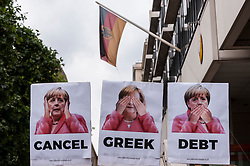 © Licensed to London News Pictures. 15/07/2015. London, UK. Demonstrators gather outside the German Embassy in Belgrave Square to protest against the recent bailout conditions imposed by the European Union. Photo credit : Stephen Chung/LNP