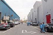 DUBAI, UAE - APRIL 30, 2016: A group of workers are leaving Alserkal Avenue in Dubai' Al Quoz Industrial Area.