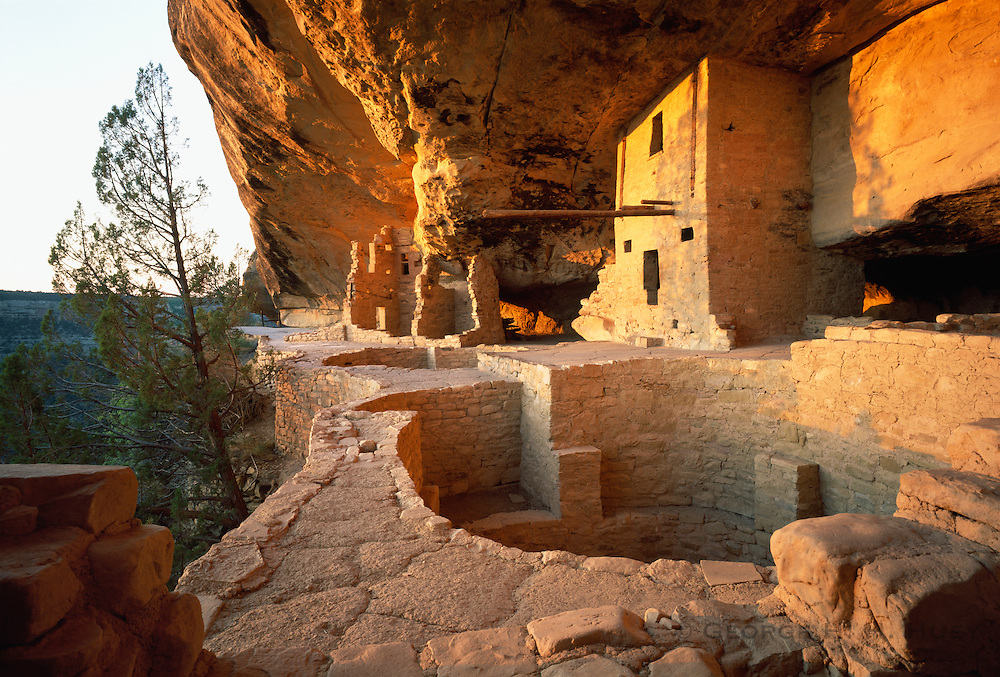 0405-1077 ~ Copyright: George H. H. Huey ~ Balcony House at sunrise w/kiva in foreground. Anasazi culture cliff dwelling in Soda Canyon, occupied from A.D. 1190-A.D. 1270's. It contained 35-40 rooms and kivas. Mesa Verde National Park, Colorado.