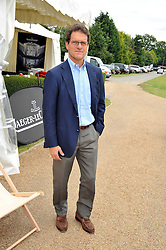 England football manager FABIO CAPELLO at a charity polo match organised by Jaeger Le Coultre was held at Ham Polo Club, Richmond, Surrey on 12th June 2009.