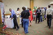 30 JULY 2012 - PHOENIX, AZ:  People walk through the Phoenix Job Fair in Phoenix, AZ. The job fair was sponsored by National Career Fairs, which organizes job fairs across the US. Several hundred people attended the job fair, with some arriving hours before it started. More than 30 employers and prospective employers were conducting interviews at the job fair. There were also resume coaches and educational institutions on site. Arizona is still grappling with the recession. The state's unemployment rate is stuck at 8.2% and the Phoenix metropolitan area has one of the highest home foreclosure rates in the United States.     PHOTO BY JACK KURTZ